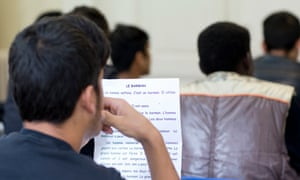 Unaccompanied minors seeking asylum learn French at the home for young refugees run by French charity Terre d'Asile.