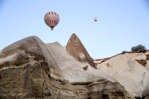 Nevşehir province, Turkey: Balloons soar over the rock pillars of Göreme national park, a Unesco World Heritage site in Cappadocia.