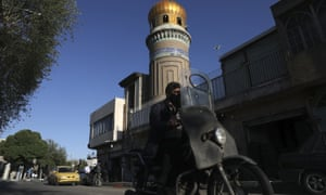 A man drives past a mosque during the Muslim holy fasting month of Ramadan, in southern Tehran, Iran, Monday, 27 April 2020.