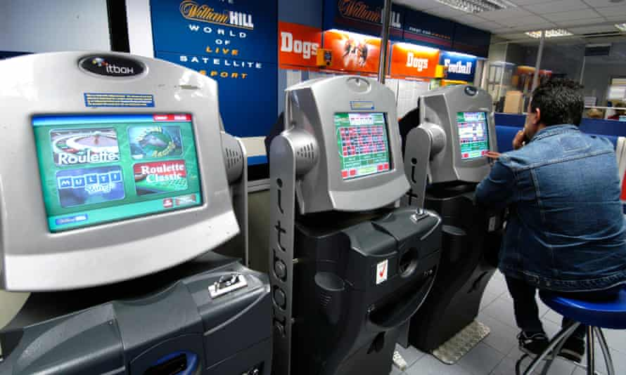 Fixed-odds betting terminals at a William Hill bookmakers.