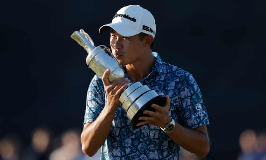 Collin Morikawa celebrates with the Claret Jug after his two-shot victory at the Open Championship.