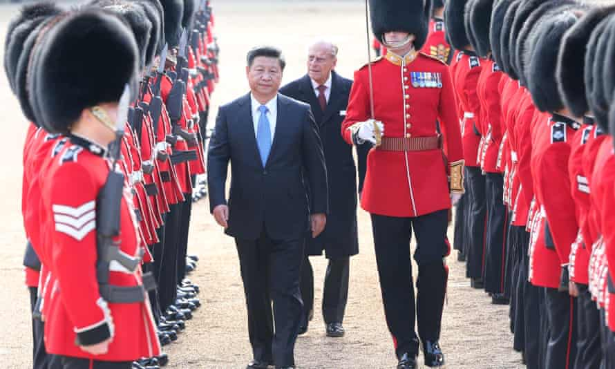 Chinese President Xi Jinping, accompanied by Prince Philip, inspects the guard of honour