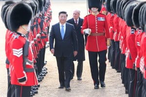 Chinese President Xi Jinping, accompanied by Prince Philip, inspects the guard of honour during a traditional ceremonial welcome held by British Queen Elizabeth II at the Horse Guards Parade.