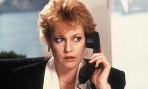 Melanie Griffith as Tess McGill, a phone to her ear, in the film Working Girl