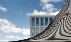 The floor-to-ceiling windows of the luxury flats overlooking the new Design Museum roof.