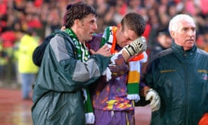 Andy Townsend consoles Shay Given after Ireland's defeat to Belgium in 1997.