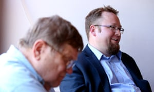 Frank Fury and Jason Wood discuss politics and religion with members of the Faith Presbyterian church men's club.