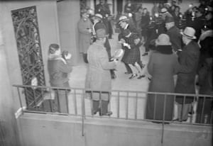Vanderbilt is escorted to her mother's home in 1934 for a visit after her aunt won custody of her.