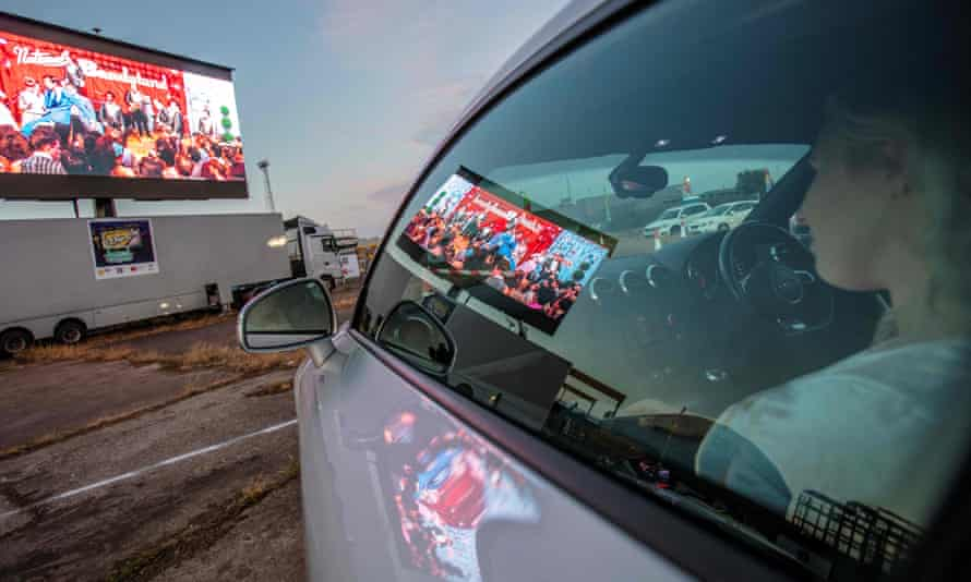 People watch Grease from their cars at a temporary drive-in cinema in Belfast shipyard.