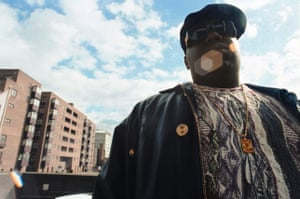 Notorious B.I.G in Paddington in London, UK. 'Having woken him up,' recalls photographer Eddie Otchere, 'we walked him into the carpark of the hotel, and against the West London skyline this image was shot and captured. What struck me about this shoot was the fact he went to his hotel room and knocked on the door and woke him up. I've not doubt he'd only had a few hours sleep and, twenty minutes after being in bed, here is in is Coogi, Versace and Kangol'