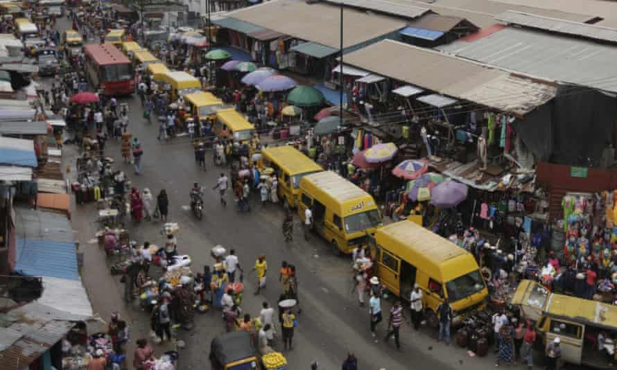 People shopping at a market in Lagos, Nigeria.