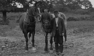 A farmhand wearing a bowler hat, circa 1908.