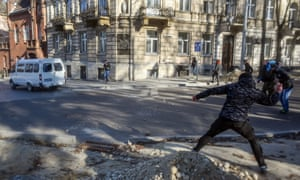 Members of far-right groups throw stones during a protest against the LGBT community in Lviv, Ukraine