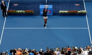 Serena Williams of the United States celebrates with the trophy after defeating Caroline Wozniacki of Denmark to win their women's singles final match on Day fourteen of the 2014 US Open.