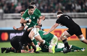 Conor Murray atempts to evade New Zealand's flanker Sam Cane.