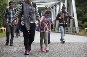 Honduran migrants walk in a group toward the U.S., as they make their way through Chiquimula, Guatemala.