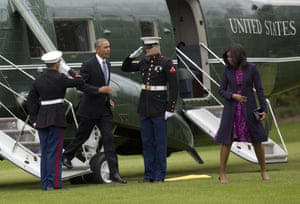 Barack and Michelle Obama disembark a helicopter