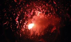 Egyptians celebrate after President Hosni Mubarak resigns
