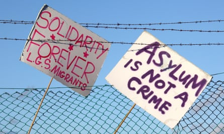 Pro-asylum protest placards