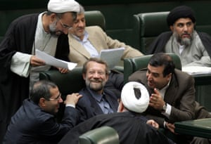 Surrounded by lawmakers in 2006, Ali Larijani, center, was then Iran's lead nuclear negotiator, and secretary of supreme national security council.