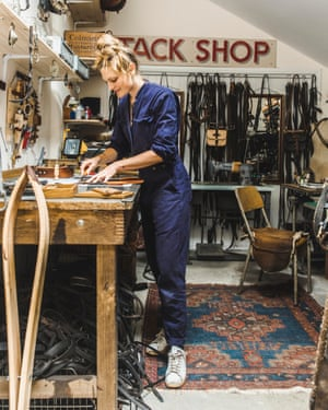 Strecker in the garage where she makes leather bags from vintage saddlery.