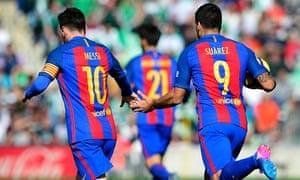 Barcelona's Uruguayan forward Luis Suárez celebrates a goal with Argentinian forward Lionel Messi.