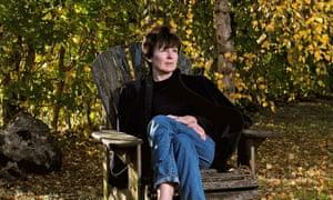 Olivia Laing sitting in her garden