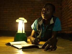 Eston Msampha, 15, has been able to study after dark since his mother Dines trained as a solar engineer
