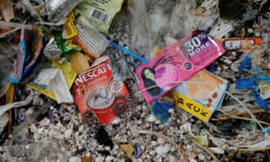 Sachets visible in a pile of rubbish