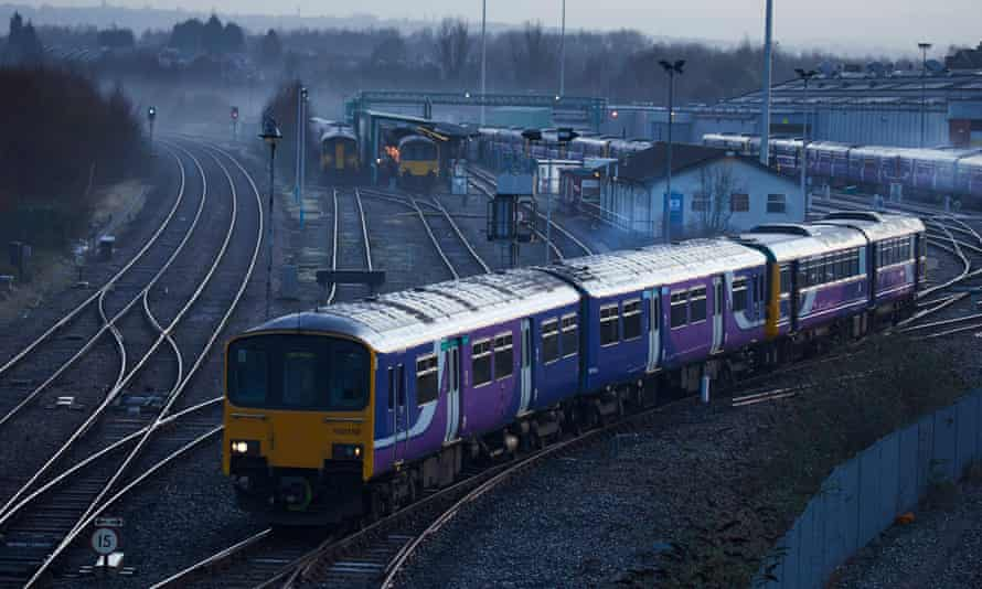 A Northern Rail train leaves a depot in Manchester