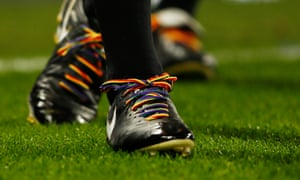 A Premier League footballer wears rainbow laces in support of the Stonewall campaign.