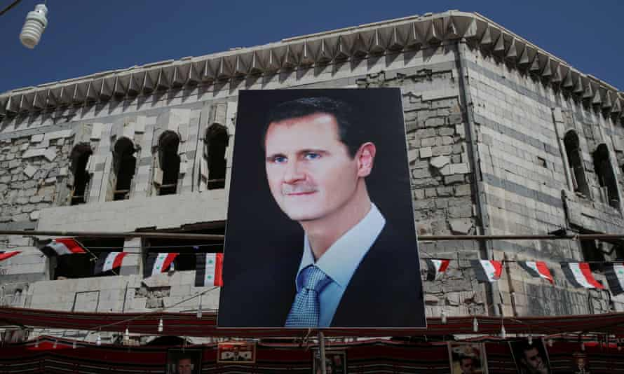 A banner depicting Syrian President Bashar al-Assad in Douma, outside Damascus, Syria, September 17, 2018. REUTERS/Marko Djurica/File Photo