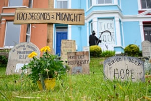Imitation grave stones outside a home in Falmouth symbolise the environmental emergency