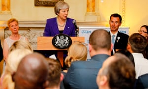Jeremy Hunt stands beside Theresa May at an NHS anniversary bash at 10 Downing Street on Wednesday night.