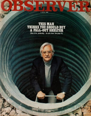 A man looking out from a corrugated iron tunnel