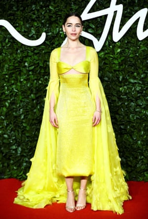 The actor Emilia Clarke wore a yellow Schiaparelli gown to present the Isabella Blow award for fashion creator to the hair stylist Sam McKnight