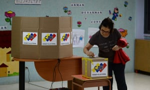 A Venezuelan votes during regional elections in Caracas.