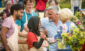 Nadiya is congratulated by judges Mary Berry and Paul Hollywood after being crowned Bake Off champion 2015.