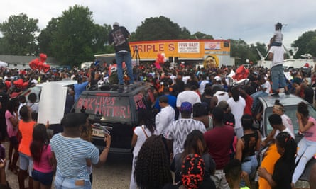 Protesters gather at the site of the shooting.