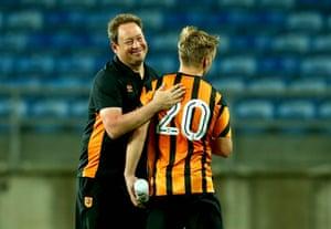 Hull manager Leonid Slutsky embraces Jarrod Bowen after their recent friendly against Benfica.
