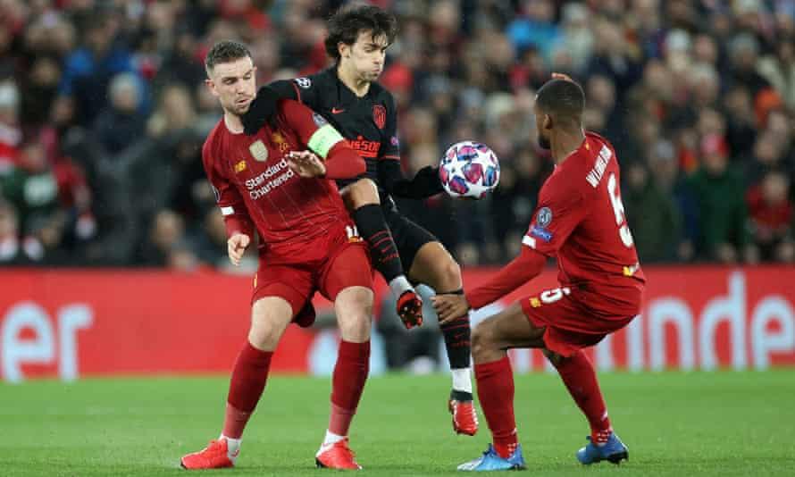 João Félix tries to progress despite the close attention of Liverpool's Jordan Henderson and Georginio Wijnaldum.