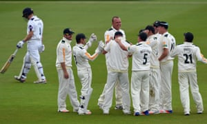 Luke Fletcher towers above his Nottinghamshire team-mates after dismissing Hampshire's Jimmy Adams caught-and-bowled in 2016