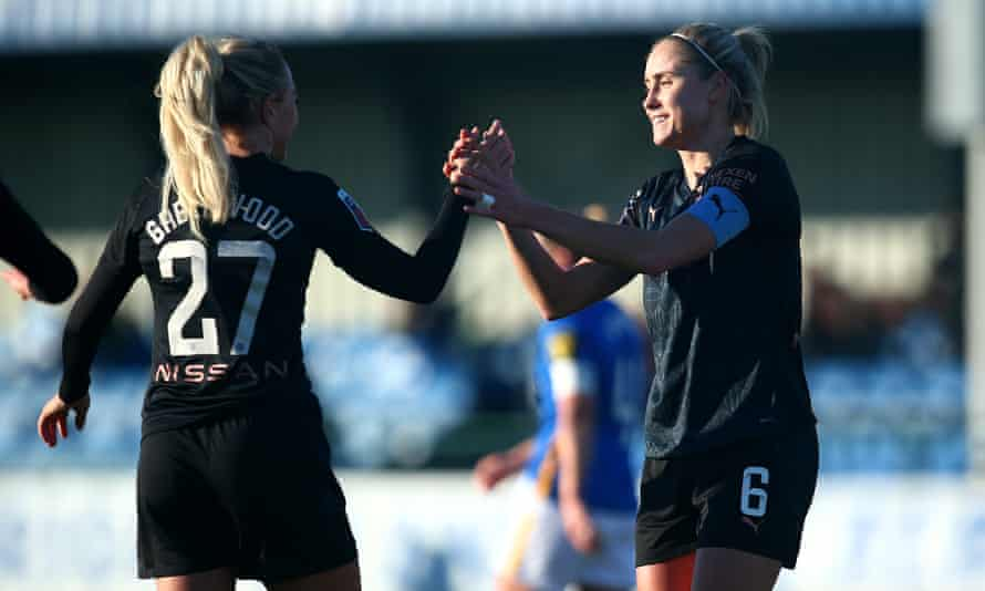 Steph Houghton (right) is congratulated by Alex Greenwood after scoring City's third.