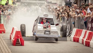 Back to the FutureThe eighth annual Soapbox derby in Hinckley. The karts ranged from fully engineered through to those held together by duck tape. This 'DeLorean' replica even produced smoke Photograph: Paul David/GuardianWitness