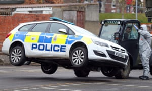 A police car being taken away by military personnel in Salisbury last year