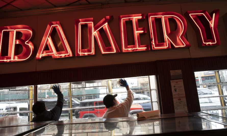Employees of Junior's Restaurant sanitize a window on Thursday in the Brooklyn borough of New York. The restaurant is closed temporarily due to the coronavirus.