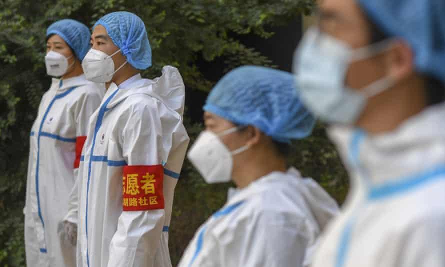 Coronavirus volunteers assemble in Urumqi, Xinjiang, as part of China's efforts to combat the virus.