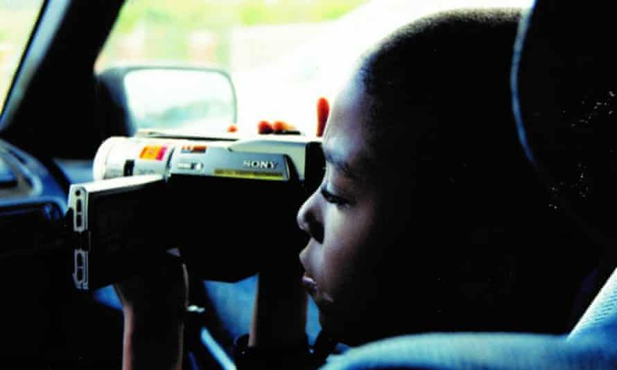 Emmanuel Durant taking videos in 17 Blocks