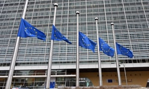 European flags fly at half mast in front of the EU Berlaymont building