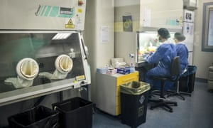 Staff at a virology lab work on tests of coronavirus on samples at San Matteo hospital, in Pavia, northern Italy.